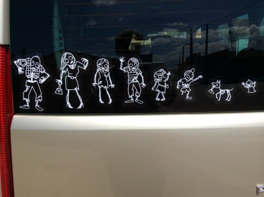 Our answer to pretentious car stickers - us as a zombie family.  Plus one dog Lastborn fell in love with in Normandy.
