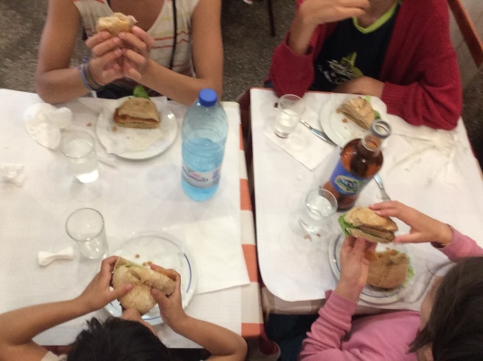 Good Friday lunch in Portugal - kids enjoying pork schnitzel sandwiches!