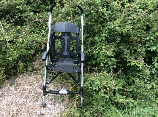 An abandoned, broken stroller...