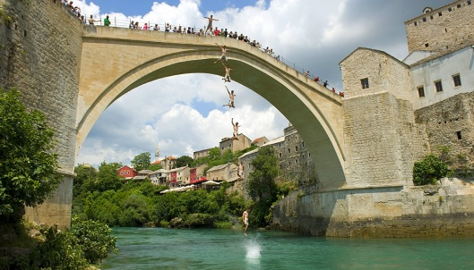 Popular pastime of jumping from bridge, Mostar, Bosnia (en.wikipedia.org)