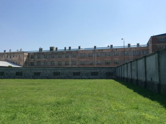 The back of the high school looks over the concentration camp yard