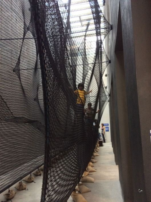 You enter Höhenrausch by taking off your shoes, putting them in a special backpack and climbing up this net!