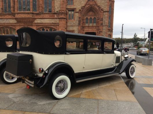 Fancy car in front of Guildhall, Derry.  Guildhall was severely bombed during the Troubles.