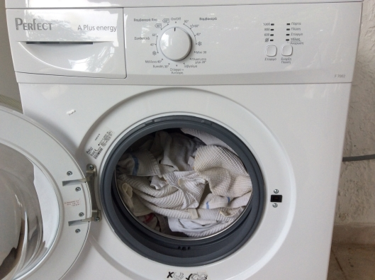 Five day installation adventure!  We take delivery of a new washing machine for our apartment owner, Greece