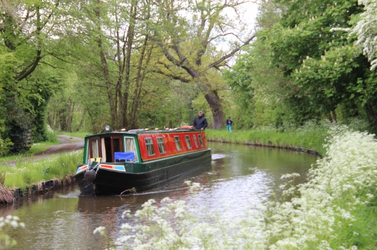 Fahbio steers narrowboat through canals of England and Wales.  Onlyboy chooses to walk the towpath.
