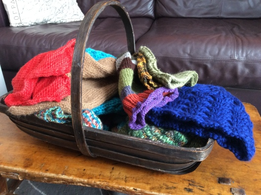 The basket I use for foraging in the summer - now full of hand knit hats!