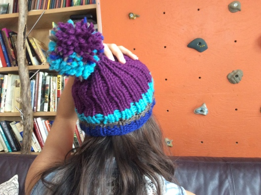 The Kur hat is the only one with a pom-pom.  1970s like my cousin...