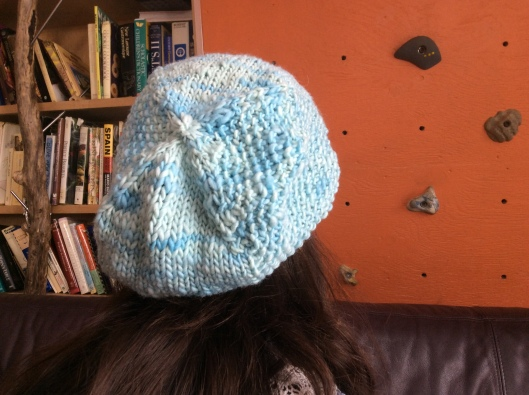 The Allthingsgood hat.  I picked this colour because I thought it would complement her skin tone perfectly.  The style is beret like Normandy but sea-cool like her cottage in Wales.